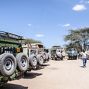 The ubiquitous Toyota Landcruisers preferred as safari vehicles are lined up in a parking lot at a designated picnic spot at Tarangire National Park in northern Tanzania not far from Ngorongoro Crater and the Serengeti.