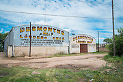 2014/11/22 – Quimili, Argentina: The warehouses of a company annoucing deforestation. The region around Quimili on the Santiago de Estero Province is being vastly converted from forestland into fields to produce soy, detroying the habitats for local species and indigenous people. (Eduardo Leal)