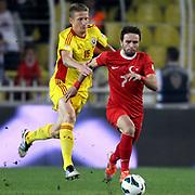 Turkey's Gokhan Gonul (R) and Romania's Nicolai Dorin Goian during their FIFA World Cup 2014 qualifying soccer match Turkey betwen Romania at Sukru Saracoglu stadium in Istanbul october 12, 2012. Photo by TURKPIX