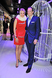 NADJA SWAROVSKI and her husband RUPERT ADAMS at a reception to celebrate the launch of 'A Crystal Christmas'  - inspired by Swarovski and held at Harrods, Knightsbridge, London on 8th November 2011.  Following the reception a private dinner was held at One Hyde Park, Knightsbridge.
