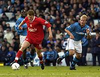 Fotball, 5. desember 2003 , Manchester City v Liverpool, AXA FA Cup, Maine Road, Manchester. <br />Liverpool's John Arne Riise og Man City's Gerard Wiekens<br />Photo. Jed Wee, Digitalsport