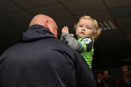 Young AFC Wimbledon fan clapping (baby) during the EFL Sky Bet League 1 match between AFC Wimbledon and Doncaster Rovers at the Cherry Red Records Stadium, Kingston, England on 14 December 2019.