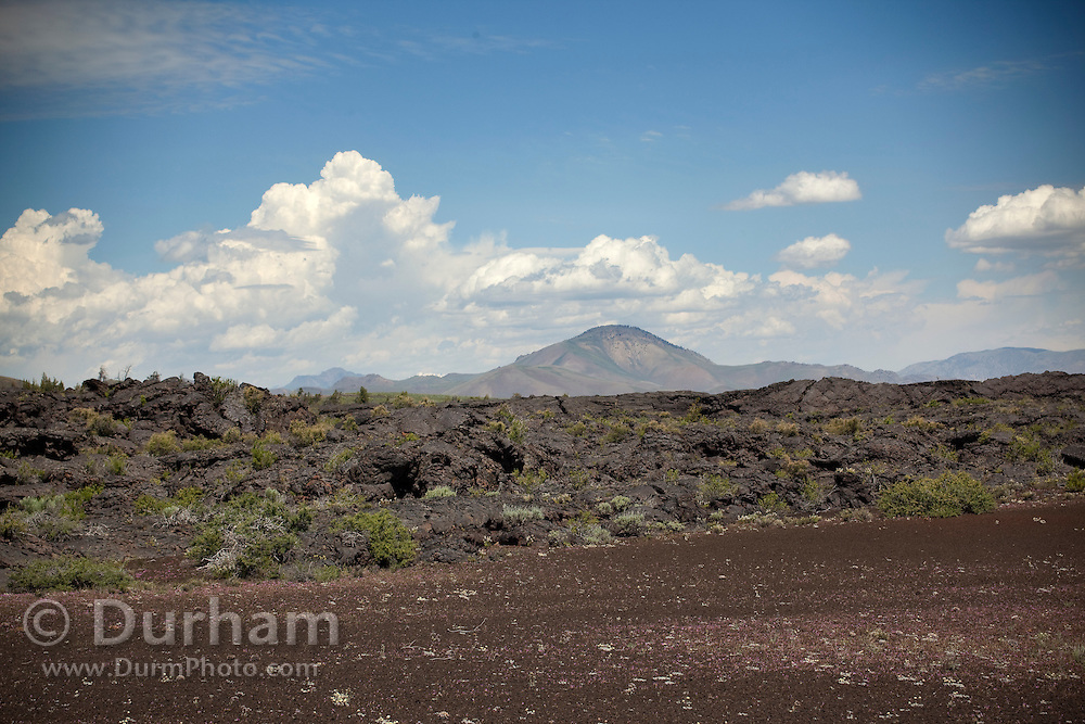 Cinder (foreground) and an old lava flow in Craters of the Moon National Monument, Idaho.
