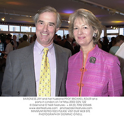 BARONESS JAY and her husband PROF.MICHAEL ADLER at a party in London on 1st May 2002.OZN 122