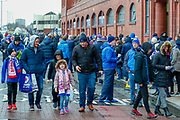 Fans young and old arrive at Ibrox for the Ladbrokes Scottish Premiership match between Rangers and Kilmarnock at Ibrox, Glasgow, Scotland on 16 March 2019.