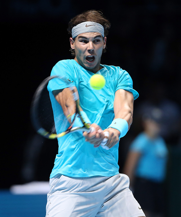 Rafael Nadal (ESP) in action during his defeat by Novak Djokovic (SRB) in their Final match today - Novak Djokovic (SRB) def Rafael Nadal (ESP) 6-3 6-4<br /> <br /> Photo by Rob Newell/CameraSport<br /> <br /> International Tennis - Barclays ATP World Tour Finals - O2 Arena - London - Day 8 -  Monday 11th November 2013<br /> <br /> © CameraSport - 43 Linden Ave. Countesthorpe. Leicester. England. LE8 5PG - Tel: +44 (0) 116 277 4147 - admin@camerasport.com - www.camerasport.com