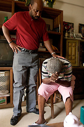 07 Oct, 2005.New Orleans, Louisiana. Hurricane Katrina aftermath.<br /> 81 year old Rosella McKoy is comforted by her nephew Kerry Young (41yrs) as she returns to see her home in the projects for the first time since the storm. Her home was miraculously spared by the floods.<br /> Photo; ©Charlie Varley/varleypix.com