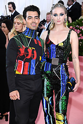 """Photo by: Doug Peters/starmaxinc.com<br />STAR MAX<br />©2019<br />ALL RIGHTS RESERVED<br />Telephone/Fax: (212) 995-1196<br />5/6/19<br />Joe Jonas and Sophie Turner at the 2019 Costume Institute Benefit Gala celebrating the opening of """"Camp: Notes on Fashion"""".<br />(The Metropolitan Museum of Art, NYC)"""