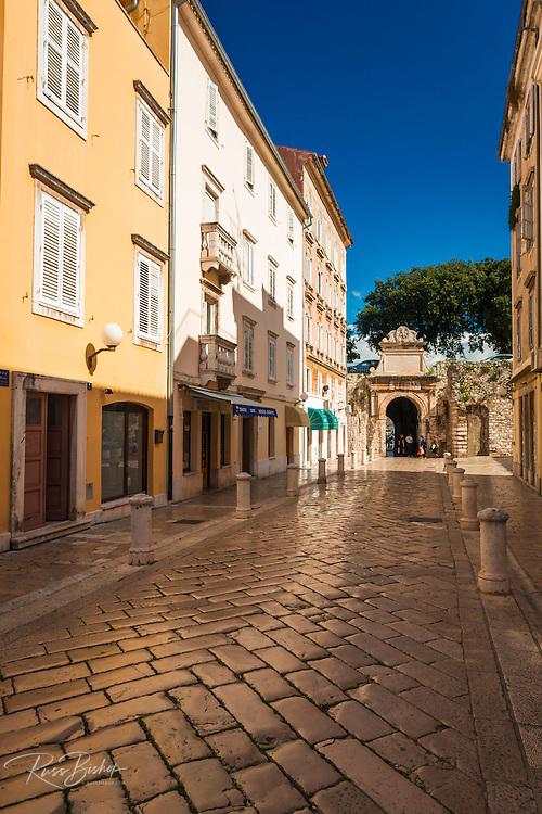 Cobblestone street and stone gate, Old Town Zadar, Dalmatian Coast, Croatia