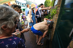 6 July 2017 -  Wimbledon Tennis (Day 4) - A man wets his head and t-shirt in a sink to help cope with the heat - Photo: Marc Atkins / Offside.