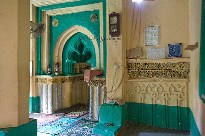Though the mosque is hundreds of years old (date uncertain) it is carefully maintained and freshly painted, mainly in green.  The qibla is framed by an unusual lobed and pointed arch.