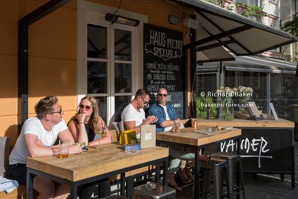 A riverside restaurant on Cankarjevo Nabrezje in the Slovenian capital, Ljubljana, on 25th June 2018, in Ljubljana, Slovenia.