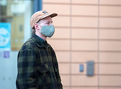 © Licensed to London News Pictures; 25/01/2021; Bristol, UK. Colston Four at court. MILO PONSFORD arrives at Bristol magistrates court. Defendants Rhian Graham, 29, Milo Ponsford, 25, Jake Skuse, 32, and Sage Willoughby, 21, are due before Bristol Magistrates' Court for their first hearing today. They have been charged with criminal damage in connection with damage to the statue of slave trader Edward Colston which was pulled down during a Black Lives Matter protest on June 7 2020 and then thrown into Bristol Harbour. Police launched an appeal to trace suspects after the event and ten people were located. Six people accepted a caution while four were referred to the CPS. The statue was later retrieved by Bristol City Council who say that the damage is costed at £3,750. Police have warned anyone planning to protest at the court hearing that they will be breaking the lockdown laws which prohibit public gatherings of more than two people to combat the Covid-19 coronavirus pandemic. Photo credit: Simon Chapman/LNP.