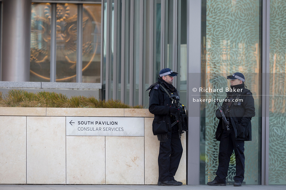 An armed police presence outside the US Embassy at Nine Elms in south London, on 16th January 2018, in London, England. On the day when the consulate opened for public business (visa applications etc.), after its controversial move from Grosvenor Square in central London to the south bank.
