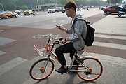 A cyclist using mobile telephones to guide him around Beijing<br /><br />Bike sharing in China has multiplied over the years with various brands offering shared bikes which can be unlocked using an application on your mobile telephone, and then locked and left anywhere for the next rider. Ofo and Mobike are the two world leaders. One of the problems is the huge over supply of bikes, which has meant many startups going out of business, and huge bike cemeteries created on the outskirts of China's mega cities, where hundred's of thousands of bikes are rusting away.