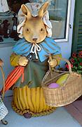 Huge Easter bunny statue holding an egg basket and umbrella.  St Paul  Minnesota USA