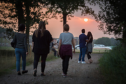 "21 August 2018, De Glind, Netherlands: Through a Pilgrim Walk, youth participants explore what it means to be on a Pilgrimage of Justice and Peace. What are the sources of inspiration, the barriers to be overcome? ""On the Moveî is the theme as 12 Dutch and 12 international youth gather for a Youth Pilgrimage in the Netherlands on 21-23 August. Gathering as part of the celebrations of the World Council of Churches 70th anniversary in 2018, the youth spend three days together to explore what it means to be young pilgrims in the ecumenical movement today."
