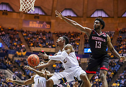 Dec 14, 2019; Morgantown, WV, USA; West Virginia Mountaineers guard Brandon Knapper (2) makes a move in the lane and shoots while guarded by Nicholls State Colonels guard Andre Jones (13) during the second half at WVU Coliseum. Mandatory Credit: Ben Queen-USA TODAY Sports