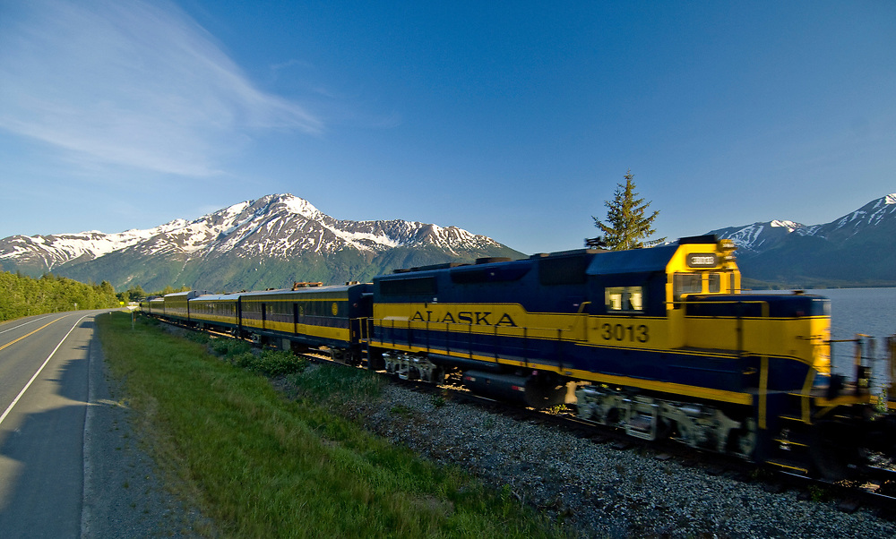 Alaska Railroad  passing along the Alaskan coast at Turnagain Arm, a tidal inlet that stretches from Anchorage to Portage