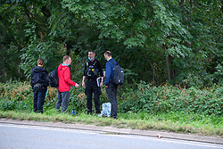 © Licensed to London News Pictures. 17/08/2021. Yarnton, UK. Police officers on the A40 in Yarnton in Oxfordshire following reports of a body being located in Cresswell Lake. Thames Valley Police with the assistance of Oxfordshire Fire & Rescue Service and Hampshire Constabulary Marine Unit recovered the body of a woman from the water. The death is currently being treated as unexplained. Photo credit: Peter Manning/LNP