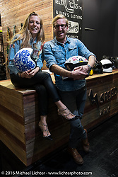 Danila Stancheris of DMD Helmets in Bergamo, Italy with her brother and business partner Davide Stancheris in Hall 10 with its all custom focus at the Intermot Motorcycle Trade Fair. Cologne, Germany. Thursday October 6, 2016. Photography ©2016 Michael Lichter.