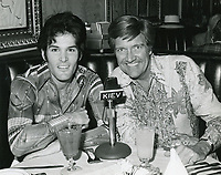 1978 Radio commentator and interviewer, Gregg Hunter, seen with ? during his KIEV radio show at the Brown Derby Restaurant on Vine St. in Hollywood