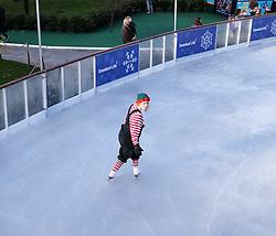 Edinburgh's Christmas 2016, Friday 18th November 2016<br /> <br /> The Edinburgh's Christmas Ice Rink in St Andrew's Square opened to the public today.<br /> <br /> A skating elf takes to the ice<br /> <br /> (c) Alex Todd | Edinburgh Elite media