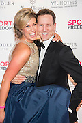 Julia Immonen, the charity organiser, and Brendan Cole,Stictly Come Dancing - UK charity, Sport for Freedom (SFF), marks Anti-Slavery Day 2015 by hosting a charity Gala Dinner, supported by Aston Martin, on Thursday 15th October at Stamford Bridge, home of Chelsea Football Club. This inaugural event brought together people from the world of sport, entertainment, media, and business to unite behind a promise to tackle the issue of modern day human trafficking and slavery.  <br /> Hosted by Sky presenters Sarah-Jane Mee and Jim White, the Sport for Freedom Gala Dinner includes guests such as jockey AP McCoy OBE; Denise Lewis, former British Olympic Gold Medal winner; BBC Strictly star, Brendan Cole; Al Bangura, former Watford FC player and Sport for Freedom Ambassador who was trafficked from Africa to the UK at the age of just 14yrs old; Made in Chelsea star, Ollie Proudlock; ITV weather presenter, Lucy Verasamy; Sky Sports F1 presenter and SFF Ambassador, Natalie Pinkham; Premier League footballers Ryan Bertrand of Southampton FC and Troy Deeney of Watford FC and champion boxer, Anthony Joshua; and The UK's first independent Anti Slavery Commissioner, Kevin Hyland OBE, who highlighted the issues of modern day slavery that face the UK and world today. <br /> The evening concluded with chart topping music from 'Naughty Boy'. <br /> Sport for Freedom are also joining forces with the Premier League Academies for an international  'Football for Freedom' tournament with their U16's players that will also involve educating those taking part about the issues surrounding modern day slavery. The final will take place at Liverpool FC's Academy on Anti-Slavery Day, 18th October.
