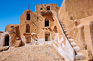 Ksar Ouled Soltane, a traditional Berber and Arab fortified adobe vaulted granary cellars, or ghorfas, situated on the edge of the northern Sahara in the Tataouine district. Tunisia, Africa. Used as a film set Star Wars: The Phantom Menace as the slave quarters of Mos Espa where the character Anakin Skywalker lived as a boy.<br /> <br /> Visit our TUNISIA HISTORIC PLACES PHOTO COLLECTIONS for more photos to browse or download or buy as prints https://funkystock.photoshelter.com/gallery-collection/Pictures-Images-Photos-of-Tunisia/C0000lMpN5pUP1CM <br /> .<br /> Visit our ISLAMIC HISTORICAL PLACES PHOTO COLLECTIONS for more photos to download or buy as wall art prints https://funkystock.photoshelter.com/gallery-collection/Islam-Islamic-Historic-Places-Architecture-Pictures-Images-of/C0000n7SGOHt9XWI