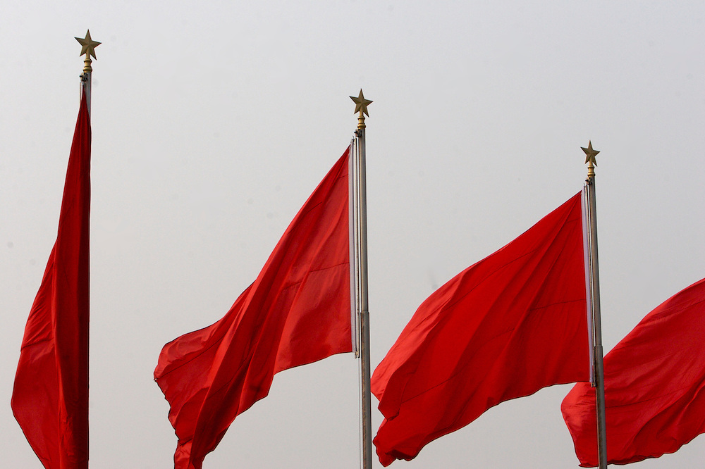 Flags at Tiananmen Square surround the Monument to the People's Heroes in Beijing,China.