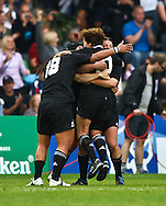 5th September 2010, Twickenham Stoop, London, England: Linda Itunu (18) and Anna Richards (10) of New Zealand join the celebrations as New Zealand win the IRB Women's Rugby World Cup final between England and New Zealand Black Ferns. New Zealand won 13-10, capturing the trophy for the 4th time.  (Photo by Andrew Tobin www.slikimages.com)