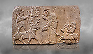 """Aslantepe Hittite relief sculpted orthostat stone panel. Limestone, Aslantepe, Malatya, 1200-700 B.C. Anatolian Civilisations Museum, Ankara, Turkey.<br /> <br /> Scene of king's offering drink and sacrifice to the god. The god is on the deer, with the bow attached to his shoulder and with a triple bundle of lightning in his hand. The king looks at the god, and makes the libation to the god while carrying a scepter with a curled end - lituus. Behind the king is a servant holding a goat for sacrifice to the god. Hieroglyphs read; """"God Parata, Strong King... """". <br /> <br /> Against a grey art background. <br /> <br /> If you prefer to buy from our ALAMY STOCK LIBRARY page at https://www.alamy.com/portfolio/paul-williams-funkystock/hittite-art-antiquities.html . Type - Aslantepe - in LOWER SEARCH WITHIN GALLERY box. Refine search by adding background colour, place, museum etc.<br /> <br /> Visit our HITTITE PHOTO COLLECTIONS for more photos to download or buy as wall art prints https://funkystock.photoshelter.com/gallery-collection/The-Hittites-Art-Artefacts-Antiquities-Historic-Sites-Pictures-Images-of/C0000NUBSMhSc3Oo"""