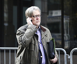 December 9, 2016 - New York, New York, United States of America - Steve Bannon, chief strategist for United States President-elect Donald Trump, makes a phone call in the street next to the Trump Tower, New York, New York, December 9, 2016..Credit: Aude Guerrucci / Pool via CNP (Credit Image: © Aude Guerrucci/CNP via ZUMA Wire)