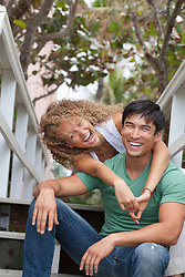 mixed race couple hanging out together laughing