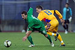 Danijel Marceta (18)  of Slovenia vs Silviu Ilie of Romania  during Friendly match between U-21 National teams of Slovenia and Romania, on February 11, 2009, in Nova Gorica, Slovenia. (Photo by Vid Ponikvar / Sportida)