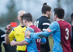Whitehill Welfare Wayne Sproule (11) picks up a straight red card.<br /> Whitehill Welfare 2 v 1 Edusport Academy, South Challenge Cup Quarter Final played 7/3/2015 at Ferguson Park, Carnethie Street, Rosewell.