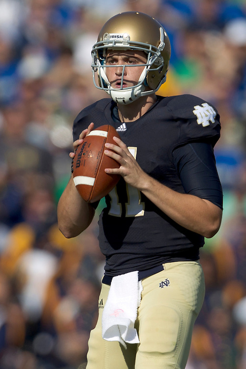 Notre Dame quarterback Tommy Rees (#11) sets in the pocket in action during NCAA football game between Notre Dame and Air Force.  The Notre Dame Fighting Irish defeated the Air Force Falcons 59-33 in game at Notre Dame Stadium in South Bend, Indiana.