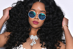 H.E.R. attends the amfAR Cannes Gala 2019 at Hotel du Cap-Eden-Roc on May 23, 2019 in Cap d'Antibes, France. Photo by Lionel Hahn/ABACAPRESS.COM