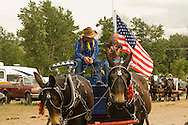 Teamster and teen girl with mule (Mulus mula) team in driving class at Montana Mule Days in Montana