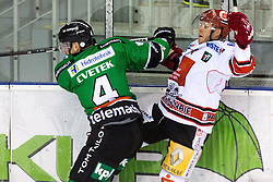 28.09.2014, Hala Tivoli, Ljubljana, SLO, EBEL, HDD Telemach Olimpija Ljubljana vs HC TWK Innsbruck, 6. Runde, im Bild Igro Cvetek (HDD Telemach Olimpija, #29) with big hit against Jeff Ulmer (HC TWK Innsbruck, #4) // during the Erste Bank Icehockey League 6th round match betweeen HDD Telemach Olimpija Ljubljana and HC TWK Innsbruck at the Hala Tivoli in Ljubljana, Slovenia on 2014/09/28. EXPA Pictures © 2014, PhotoCredit: EXPA/ Sportida/ Matic Klansek Velej<br /> <br /> *****ATTENTION - OUT of SLO, FRA*****