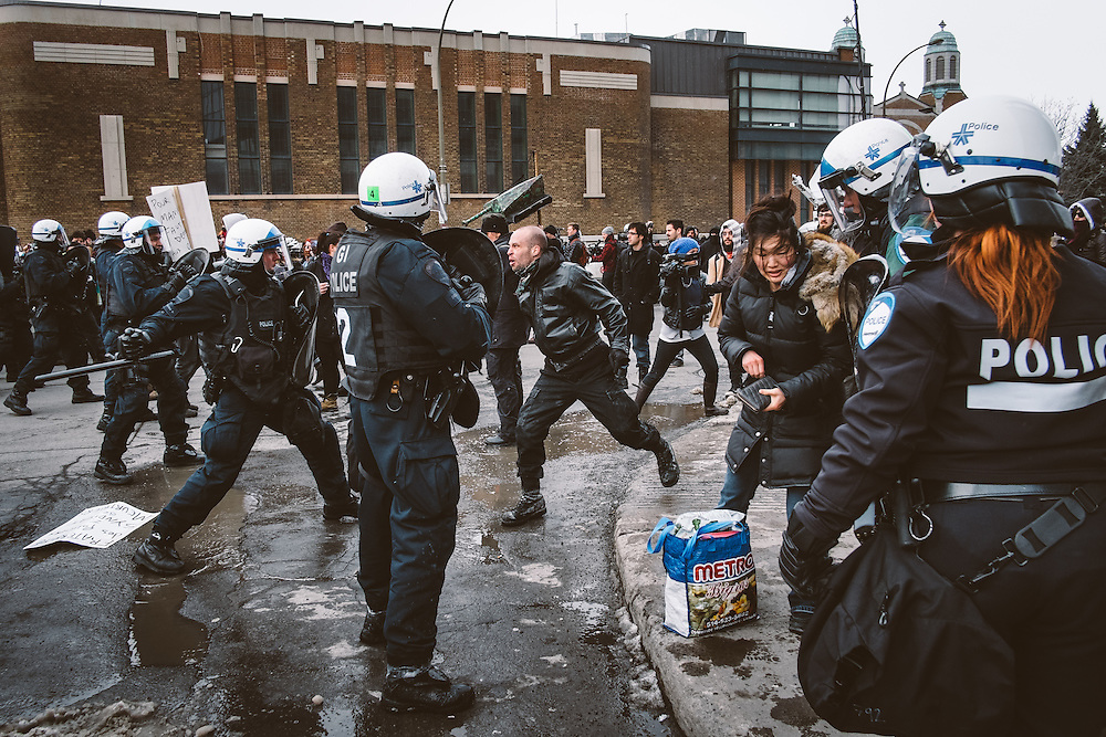 The Montreal Police (SPVM) kettle and quash the anti police brutality protest on March 15, 2014. The gathering was declared illegal within minutes of beginning, and the overwhelming show of force by the SPVM killed the protest in its cradle.