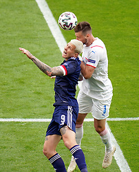 Czech Republic's Ondrej Celustka (right) and Scotland's Lyndon Dykes battle for the ball in the air during the UEFA Euro 2020 Group D match at Hampden Park, Glasgow. Picture date: Monday June 14, 2021.