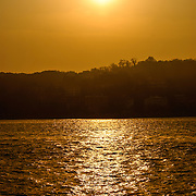 Golden sunset due to haze with reflection on the Bosphorus in Istanbul, Turkey.