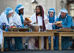 © London News Pictures. 06/04/2012. London, UK.  An actor playing Jesus at the last supper during a performance of  The Passion of Jesus  in front of thousands of people in Trafalgar Square in central London, England on  April 6, 2012  to mark Good Friday. The actors come from the Wintershall Estate in Surrey. Photo credit :  Ben Cawthra/LNP