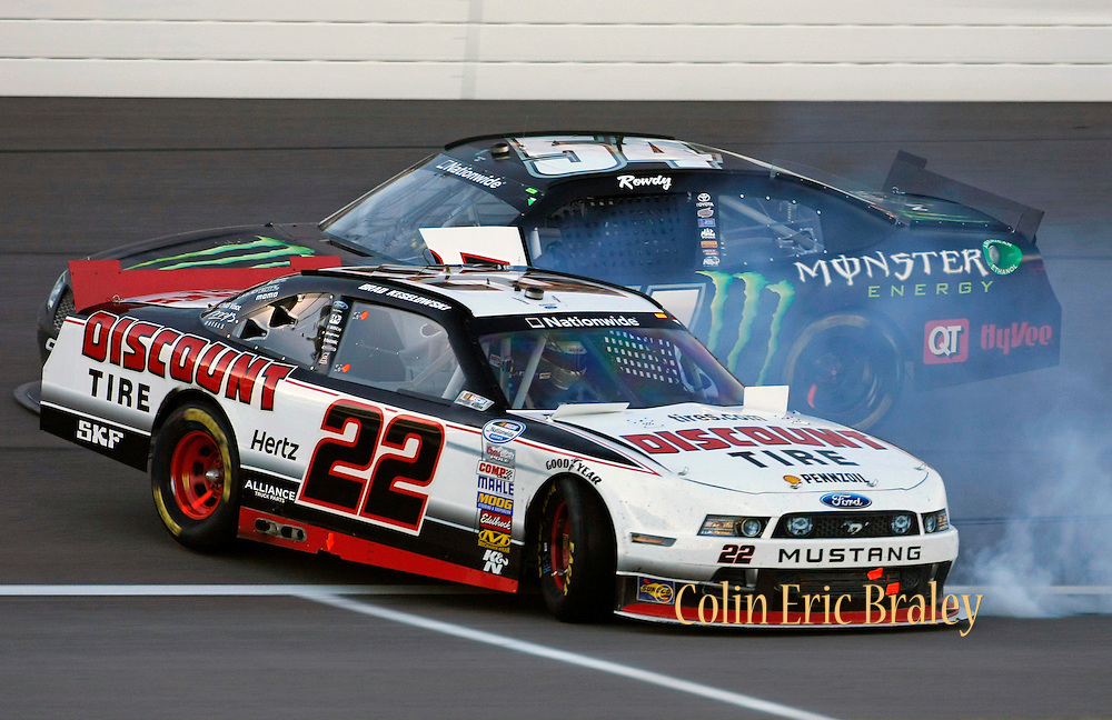 Brad Keselowski (22) spins out after getting hit from by Kyle Busch (54) during a NASCAR Nationwide Series auto race at Kansas Speedway in Kansas City, Kan., Saturday, Oct. 5, 2013. (AP Photo/Colin E. Braley)