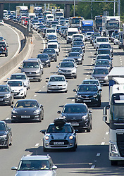 ©Licensed to London News Pictures 28/08/2020 Westerham,UK. Bumper to bumper traffic coastbound on the M25 in Kent near Westerham this afternoon. The big August bank holiday staycation getaway has started as bank holiday travellers look to get away before schools go back. 18 million cars are expected on the roads this weekend with rail cancellations due to engineering works causing delays. Photo credit: Grant Falvey/LNP