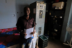 ALEXANDRA SOUTH AFRICA - APRIL 25: A man poses. During intensified testing and screening on Freedom Day, screening and testing includes people over over 60, flu-like symptoms, comorbid conditions, like diabetes, asthma, hypertencsion, HIV and tuberculosis on April 25, 2020 in Alexandra South Africa. Under pressure from a global pandemic. President Ramaphosa declared a 21 day national lockdown extended by another two weeks, mobilising goverment structures accross the nation to combat the rapidly spreading COVID-19 virus - the lockdown requires businesses to close and the public to stay at home during this period, unless part of approved essential services. (Photo by Dino Lloyd)