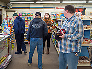 """25 FEBRUARY 2020 - BUTTERFIELD, MINNESOTA: Shoppers in the grocery section of the True Value Hardware Store in Butterfield, MN, a farming community of about 500 people 130 miles southwest of the Twin Cities. The town has been a """"food desert"""" for 10 years after its only grocery store closed in 2010. Barb Mathistad Warner and Mark Warner purchased the True Value store in Butterfield in December, 2018 and started selling groceries in the store in May, 2019. For residents of Butterfield going to a grocery store meant driving 10 miles to St. James, MN, or 20 miles to Windom, MN, the two nearest communities with grocery stores. The USDA defines rural food deserts as having at least 500 people in a census tract living 10 miles from a large grocery store or supermarket. There is a convenience store in Butterfield, but it sells mostly heavily processed, unhealthy snack foods that are high in fat, sugar, and salt.    PHOTO BY JACK KURTZ"""