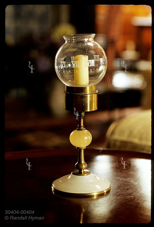 French, 19th-c. candle lamp in Queen Mother's Sitting Room is clock w/numbers etched in rotating glass globe; Glamis Castle, Scotland.