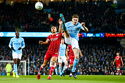 Bobby Reid of Bristol City and John Stones of Manchester City compete for the ball - Rogan/JMP - 09/01/2018 - Etihad Stadium - Manchester, England - Manchester City v Bristol City - Carabao Cup Semi Final First Leg.